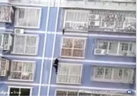 Кинески спајдермен – Се качи на зграда и спаси дете кое висеше на петти спрат (ФОТО)